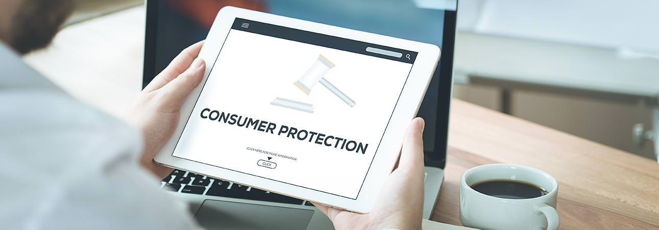 A person looking on consumer protection information their tablet