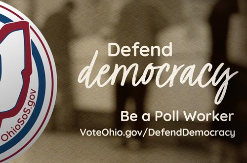 a hand holding an Ohio voted sticker with the words defend democracy to the right